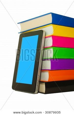 Stack Of Colorful Books And Tablet Pc