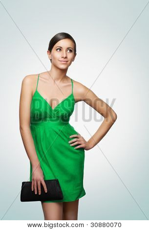 Girl with the purse on light background