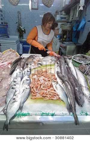 Seller on the fish market