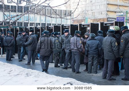 MOSCOW - MARCH 10: Police cordon on a participants of the protest manifestation against falsification of the president election, Noviy Arbat in Moscow. March, 10, 2012 in Moscow