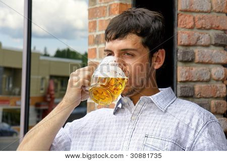 Young Man Binging On Beer