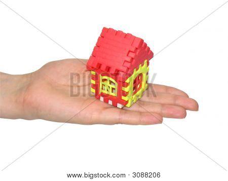 Puzzle casa en mano