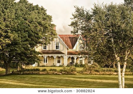 A north American style old farm house in the country. Victorian architecture.