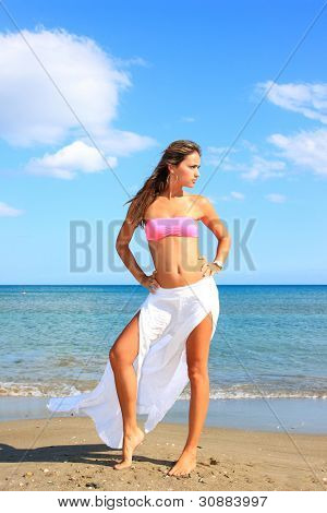 young woman showing her curvaceous body in bikini at beach
