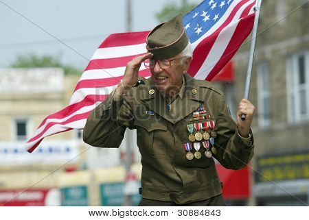 NEW YORK - MAY 29:  An unidentified veteran salutes as he marches in the Little Neck/Douglaston Memorial Day Parade May 29, 2006 in Queens, NY.