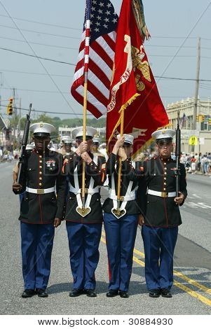 NEW YORK - MAY 29:  U.S. Marine color guard march in the Little Neck/Douglaston Memorial Day Parade May 29, 2006 in Queens, NY.