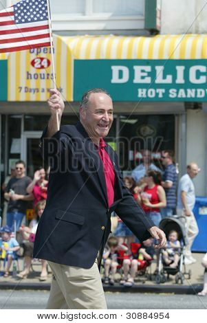 NEW YORK - MAY 29: Senator Charles Schumer (D-NY) waves as he attends the Little Neck/Douglaston Memorial Day Parade May 29, 2006 in Queens, NY.