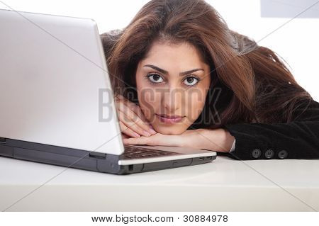 Girl Resting Head On Laptop