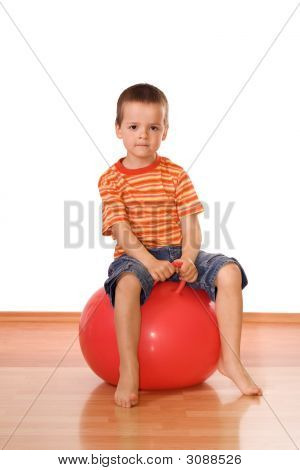 Serious Boy With Gymnastic Ball
