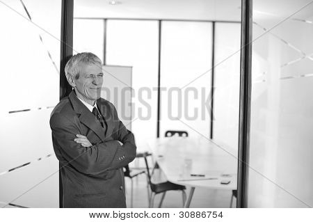 Elderly businessman winking