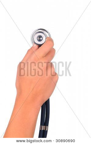 Closeup of a woman's hand holding a stethoscope over a white background. Back of hand, wrist and instrument only in vertical format.