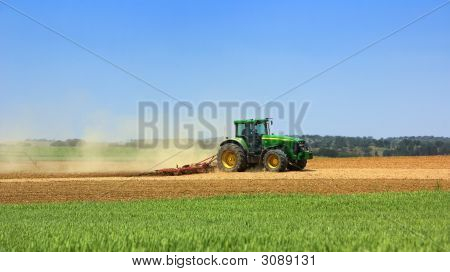 Green Tractor In The Field.