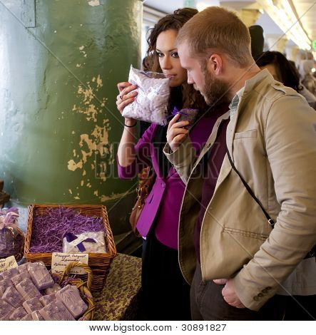 Couple Shopping At The Market For Soups And Lavender.