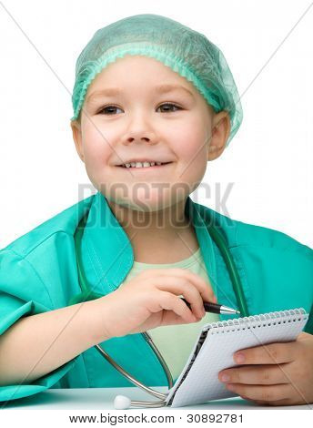 Cute little girl is playing doctor prescribing treatment in her notepad, isolated over white