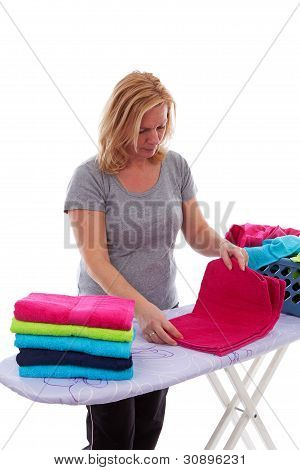Housewife Is Folding Towels