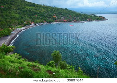 Clear tropical sea and green hills. East of Bali island (Amed)