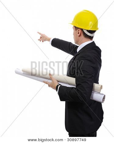 Engineer male with blueprints and helmet pointing