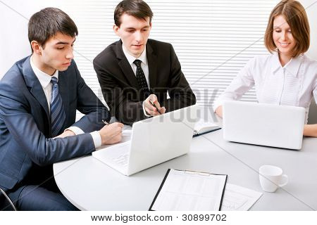 Group of young business people working together at a meeting