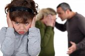 picture of pouting  - Little girl blocking out her parents - JPG