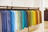 Fashionable Clothing On Hangers In Shop. Sport Of T Shirts Are Hanging On Clothes Hanger , Colorful  poster