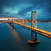 San Francisco Bay Bridge with San Francisco downtown in background poster