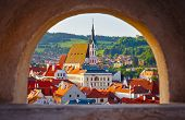 Czech Krumlov Czech Republic view at old town through window with arch. Landmark and traveling. poster