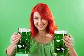 foto of st patrick  - Photo of a beautiful redhead holding two huge mugs of green beer for St - JPG