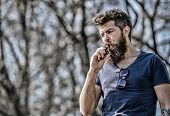 Man Long Beard Relaxed With Smoking Habit. Man With Beard And Mustache Breathe Out Smoke. Stress Rel poster