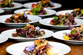 image of catering  - plated salads during a catered event or wedding