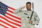 Young Serious Ranker Standing Near American Flag And Holding Hand Near Head, Ready For Army. Soldier poster