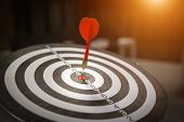 Red Dart Target Arrow Hitting On Bullseye With,target Marketing And Business Success Concept - Image poster
