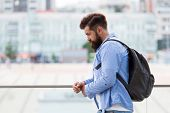 Tourist Handsome Thoughtful Hipster Backpack. Man With Beard And Rucksack Explore City. Travelling C poster