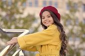 Kid Girl Bright Hat Beret. Autumn Hat Fashion Accessory. French Trend Fall Season. Girl Walk Defocus poster