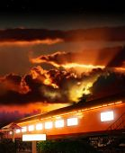 foto of boxcar  - Dramatic fantasy concept photo of a glowing old railway boxcar against dramatic sunset - JPG