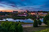 Panorama View On Evening In Old Town On The Bank Of Wide River With Evening Fluffy Curly Rolling Cir poster