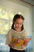 Pupil In School Uniform With Braids. Girl Schoolgirl At School With Books In School Uniform. Trainin poster