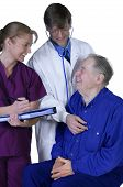 picture of medical examination  - Doctor and nurse examining elderly patient friendly exchange - JPG