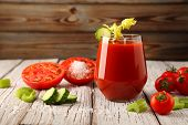 Tomato Juice From Fresh Tomatoes And Celery Stalks With Juicy Tomatoes, And Slices Of Sliced Cucumbe poster