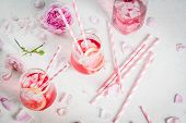 Summer Refreshment Drinks. Light Pink Rose Cocktail, With Rose Wine, Tea Rose Petals, Lemon. On A Wh poster