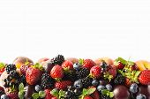 Mix Berries And Fruits On White Background. Ripe Blackberries, Strawberries, Blackcurrants And Plums poster