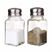 foto of salt shaker  - Salt and black pepper in shakers closeup isolated on white - JPG