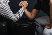 Closeup Of Two Businessmen Competing In Arm Wrestling On A Dark Blue Background. Challenge, Competit poster