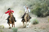 picture of buckaroo  - Two Cowboys galloping and roping through the desert - JPG