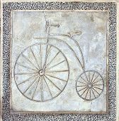 foto of penny-farthing  - A path for bicycles is marked in concrete with the image of an old style penny - JPG