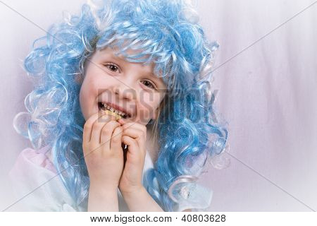 little girl with blue hair eating a cookie