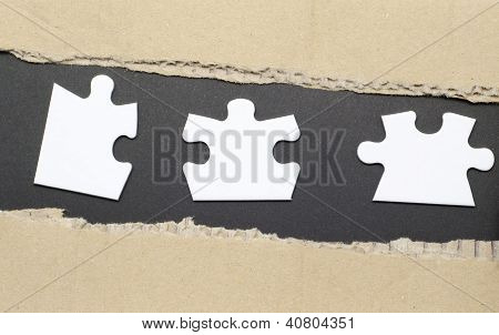Torn Paper and jigsaw puzzle