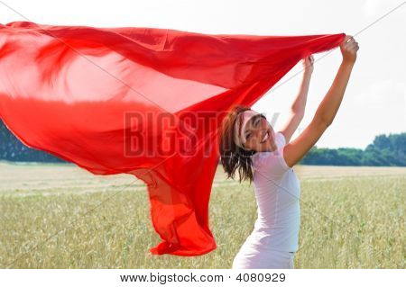 The Smiling Girl With A Red Shawl Flying On A Wind.