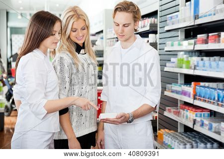 Pharmacist helping womain in drug store