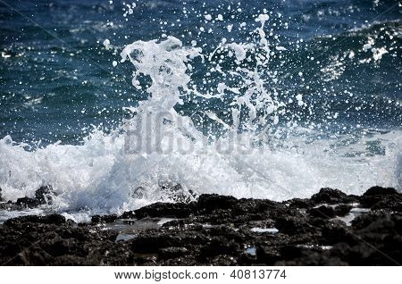 Waves crushing the shoreline, beautiful wild seascape