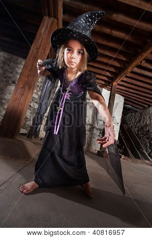 Young Witch Pointing Her Staff